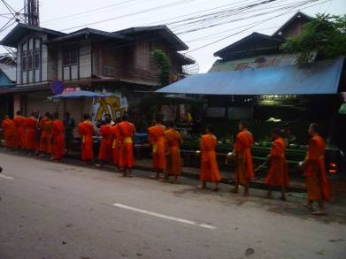 Every morning the locals queue to give an offering to the monks usually sticky rice It's their way of making merits